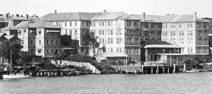 The view of the Department of Agriculture and Stock from the river, 1930s. Queensland State Archives ID1019066.