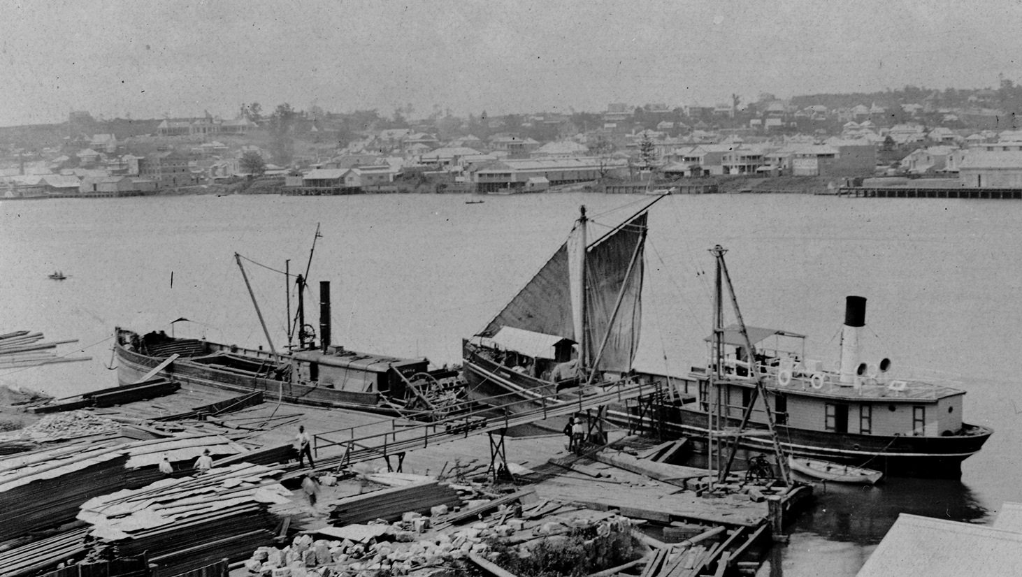 The Gneering (left) and the Tarshaw (right) berthed at Pettigrew's Wharf, downstream from Queen's Wharf, circa 1892. SLQ image 64740-2.